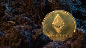 Mining crypto currency - Ethereum. Online money coin in the dirt ground. Digital currency, block chain market, online business.  stock footage