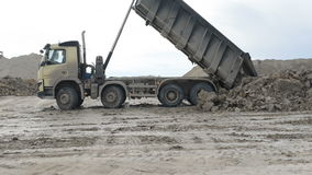 Mining dump truck unloading. Mining dump truck working unloading in the sand quarry stock footage