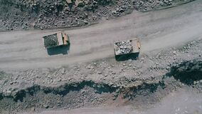 Free Mining Dump Trucks In Large Granite Open Pit Mine. Loaded Trucks Rides On Road Quarry Ledge Drone Chase Top View Stock Image - 181200841