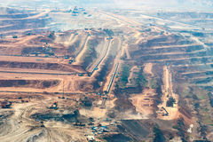 Mining dump trucks working in Lignite coalmine lampang thailand Stock Photo