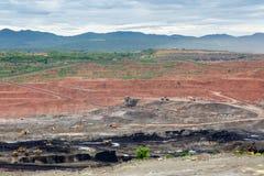 Mining dump trucks working in Lignite coalmine Stock Image