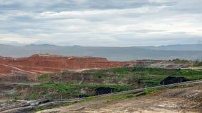 Mining dump trucks working in Lignite coalmine Stock Photo