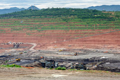 Mining dump trucks working in Lignite coalmine Stock Photography