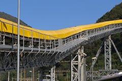 Mining equipment. Conveyor belt detail on mining site Royalty Free Stock Images