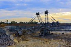 Mining excavator. Brown coal mining excavator inden Royalty Free Stock Photo