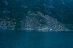 Mining in the fjord of norway geiranger royalty free stock photography