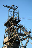 Mining Headframe. Elevator winder unit at a derelict Cornish tin mine. Photographed in late afternoon sunlight Stock Photography