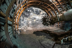 Mining machine in coal mine. Fisheye view of mining machine drilling organ, modern machinery in coal mine, tunnel drilling machine used in Alps (Alpina royalty free stock images