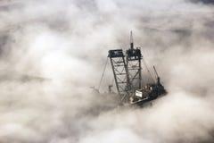 Mining machine mist Royalty Free Stock Photo