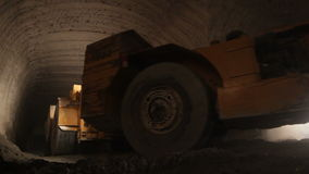 Mining Machinery Moves in Limestone Mine stock footage