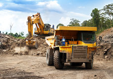 Mining machines. Monster machines working on site Royalty Free Stock Photos