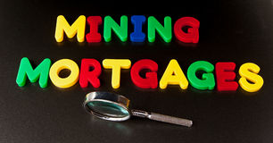 Mining mortgages Stock Photography