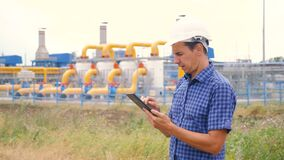 Mining oil gas production industry concept. Engineer man power and energy using digital tablet lifestyle . worker a in