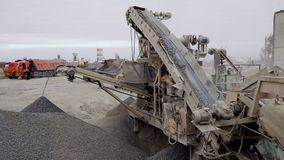 The mining process machine mining ore into fine raw materials stock video footage