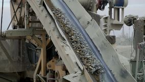 The mining process machine mining ore into fine raw materials stock footage