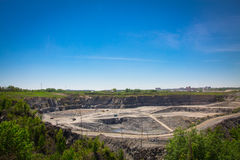 Mining quarry with moving industrial cars Stock Photo
