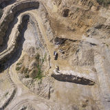 Mining quarry with special equipment, open pit excavation. Sand Stock Photos