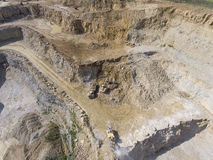 Mining quarry with special equipment, open pit excavation. Sand Stock Image