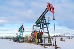 Mining and quarrying. Installations for the extraction of oil from the bowels of the Earth. Pumpjack is the overground drive for a stock photos