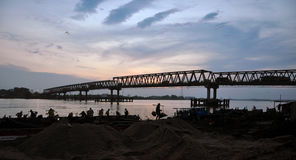The mining of sand in the river. Near the bridge length of the river in Palembang Sumatra Indonesia Asia Stock Image