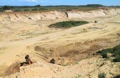Mining, sandpit. POLEWOJE, KALININGRAD REGION, RUSSIA — JUNE 18, 2014: Mining, sandpit in the sunny summer day Royalty Free Stock Photos