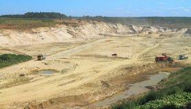 Mining, sandpit. POLEWOJE, KALININGRAD REGION, RUSSIA — JUNE 18, 2014: Mining, sandpit in the sunny summer day Royalty Free Stock Image