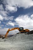 Mining Site. Excavator at the Mountain Mining Site Stock Images