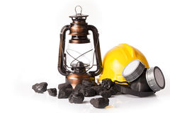 Mining tools with protective helmet, ear muffs and oil lantern Royalty Free Stock Photo