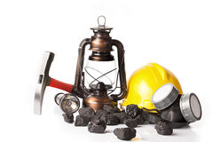 Mining tools with protective helmet, ear muffs and oil lantern. On white background Stock Photo