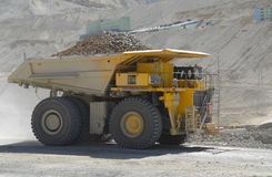 Mining truck. Powerful and huge truck loaded with copper mining Stock Image