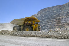 Mining truck. And heavy with big yellow copper ore Stock Image