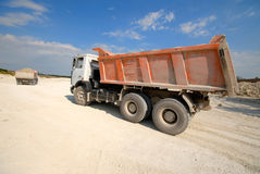 Mining truck. On blue on  background of  blue sky in career Stock Image