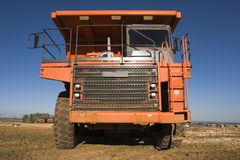 Mining truck. Front view of a big orange mining truck at worksite Stock Photography