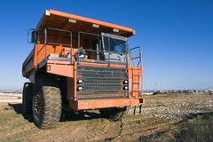 Mining truck. A picture of a big orange mining truck at worksite Royalty Free Stock Image