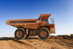 Mining truck. A picture of a big orange mining truck at worksite Stock Image
