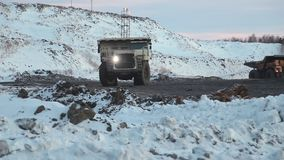 A mining truck is carrying coal. Open pit coal mining in winter stock video footage