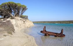 Mining Truck Discarded in Lake. An old mining truck, rusting in the gypsum lake at Inneston, Innes National Park, Yorke Peninsula, South Australia. Left by the Royalty Free Stock Image