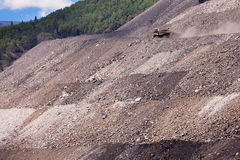 Mining truck on haul road at tailings hill side Royalty Free Stock Images