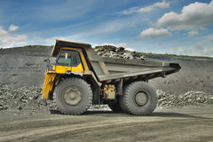 Mining truck. Heavy mining truck loaded with iron ore on the opencast Stock Images