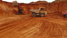 Mining truck moving at sand mine. Mining machinery working at sand quarry stock video