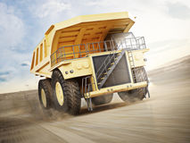 Mining truck transporting materials down a dirt road . Stock Images