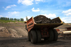 Mining truck unload coal Stock Images