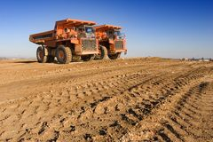 Mining trucks royalty free stock images