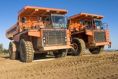 Mining trucks. A picture of a big orange mining trucks at worksite Royalty Free Stock Photography