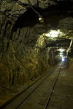 Mining tunnel underground. A long mining tunnel underground railroad Stock Images