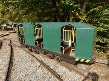 Mining wagon train. Green mining wagon train on rails Stock Photos