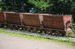 Mining wagons. Old mining wagons which were used to bring out various metals from the underground are today left abandoned Stock Photo