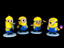 The Minions for Despicable Me Franchise. On a black backdrop stock images