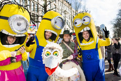 Minions on Mardi Gras Parade. As yellow minions costumed happy young people in Duesseldorf on street carnival