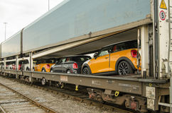 Minis being exported, Southampton. SOUTHAMPTON, UK - MAY 31, 2014: A train full of brand new Mini cars at Southampton about to be exported by ship from the docks Royalty Free Stock Photo